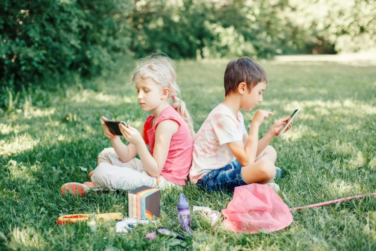 children gadgets screen time online internet gen z play smartphone outdoor together boy girl real t20 WgQgY4 scaled 1